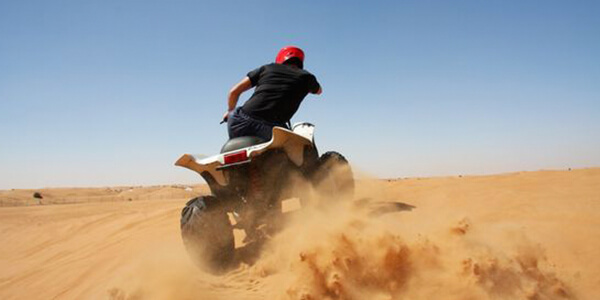 Quad biking, sand boarding, off-roading, dirt-biking at Dubai Desert
