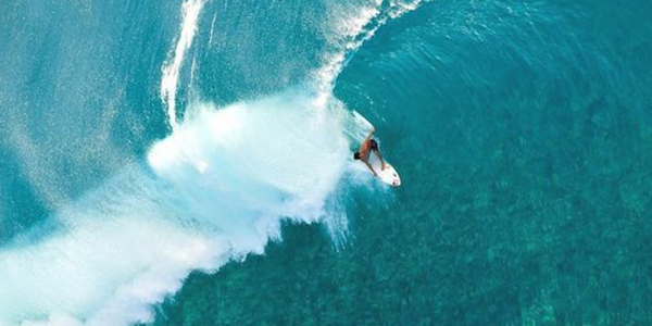 Go surfing at Hawaii